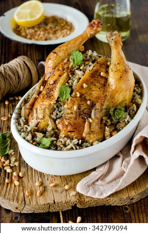 Chicken stuffed with rice and pine nuts
