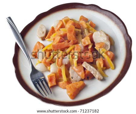 Chicken Sweet Potato and Pearl Onion Dinner with Sauce and Yellow Pepper Slivers. - stock photo