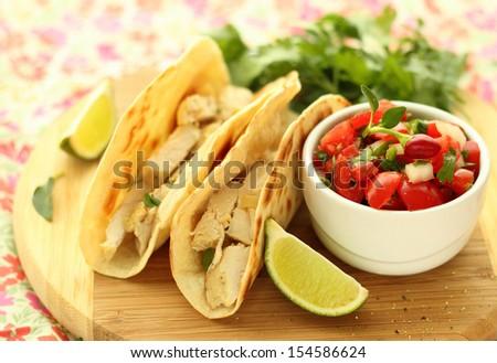 Chicken tacos and salsa fresco. - stock photo