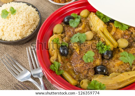 Chicken Tagine - Moroccan chicken tagine with olives, preserved lemon and fennel, served with couscous. - stock photo