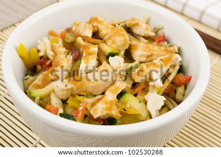 Chicken Teriyaki Noodles - Chicken noodle salad with teriyaki sauce. - stock photo