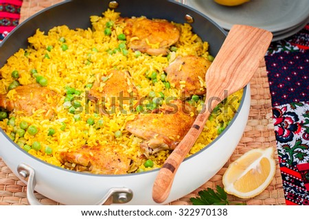 Chicken Thigh and Rice Biryani with Green Peas in a Skillet - stock photo