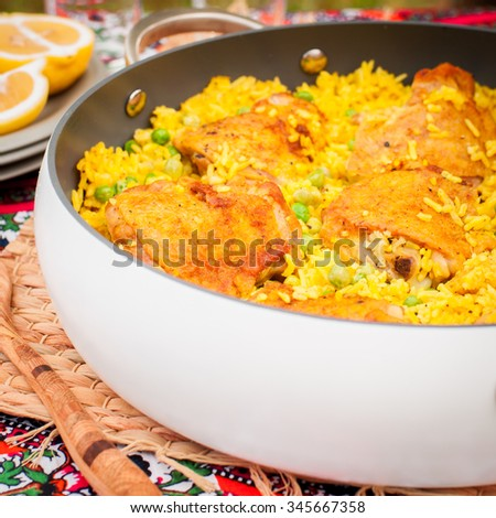 Chicken Thigh and Rice Biryani with Green Peas, square, copy space for your text - stock photo