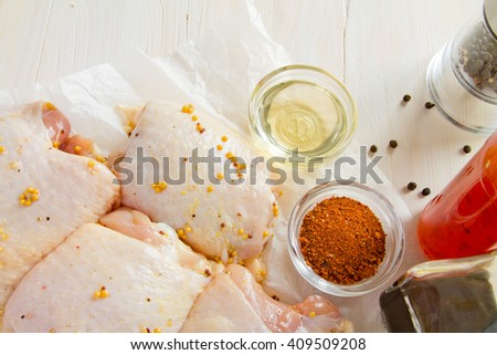 Chicken thighs. Spice. Chili pepper , soy sauce , mustard grain - stock photo