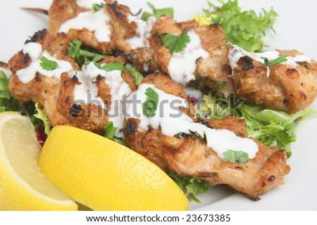 Chicken tikka with yougurt - stock photo