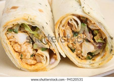 Chicken tikka wrap sandwich with yoghurt & mint dressing - stock photo