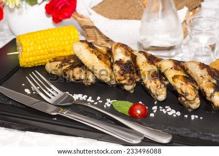 chicken wings are grilled - stock photo
