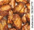 Chicken wings barbequed. - stock photo