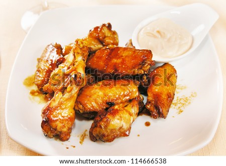 Chicken wings on a plate - stock photo