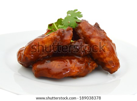 Chicken wings with barbeque sauce in white plate on white  - stock photo