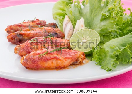 Chicken wings with cayenne pepper sauce - stock photo