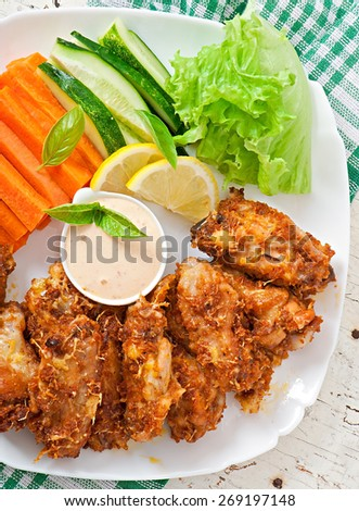 Chicken wings with parmesan cheese in the oven - stock photo