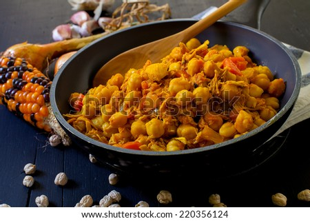 chicken with chickpea and spices cooked indian style - stock photo