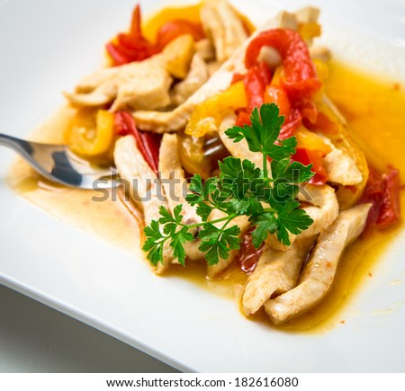 Chicken with peppers and curry  - stock photo