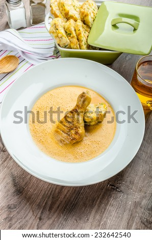 Chicken with red pepper sauce with original czech dumplings and beer.