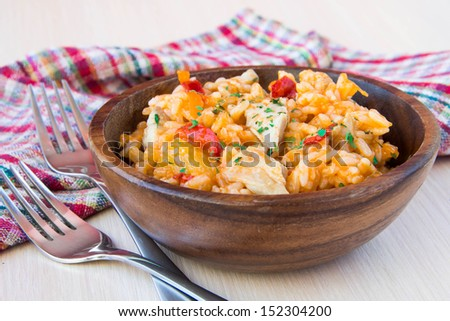 Chicken with rice and vegetables in sour-sweet sauce Chinese style in wooden bowl - stock photo