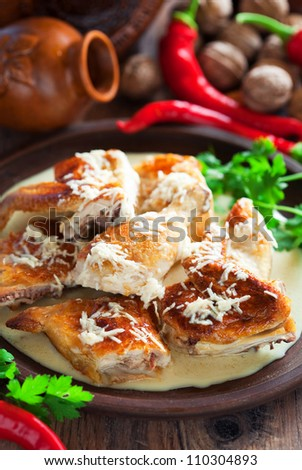 Chicken with sauce of milk and garlic (Georgian cuisine), selective focus