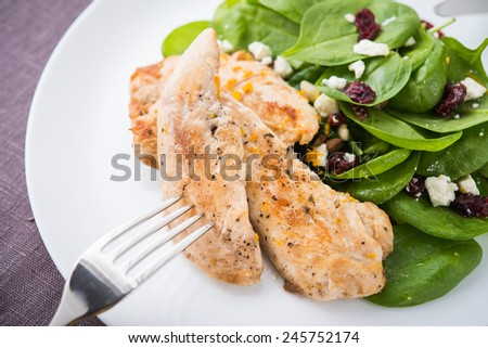Chicken with spinach salad. Healthy food. - stock photo