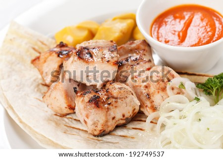 chicken with tortilla and sauce