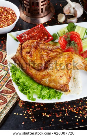 Chicken with vegetables. Top view