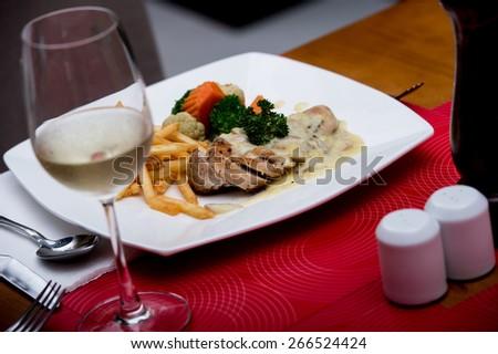 Chicken with White Wine,Prawns and beef blocks served with white wine. - stock photo