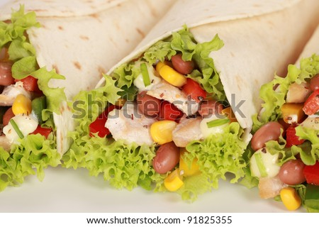 Chicken wrap sandwich filled with beans, lettuce and corn