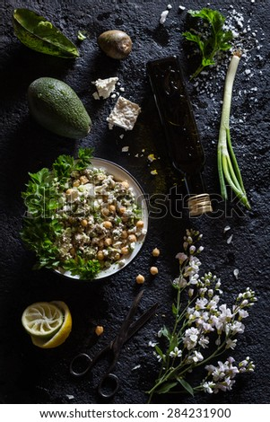 Chickpea, Avocado, Green Onion and Feta Cheese Salad. Black Concrete Background. Overhead View - stock photo