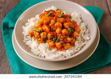 Chickpea curry with basmati rice  - stock photo