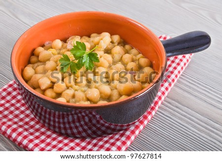 Chickpea soup in terracotta bowl. - stock photo