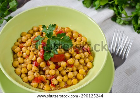 Chickpea stew with vegetables. Chickpeas, tomatoes, red pepper, garlic cooked with olive oil. - stock photo