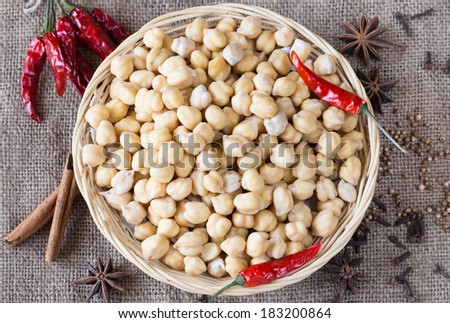 Chickpeas and spices. Ingredients for Indian food. Top view. - stock photo