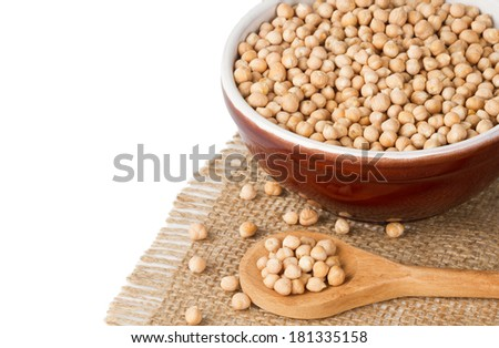 Chickpeas in wooden spoon and bowl with chickpeas isolated on white - stock photo