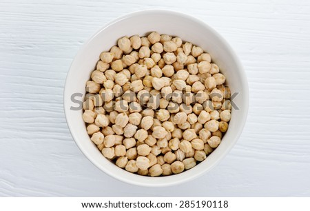 chickpeas isolated on wooden background. - stock photo