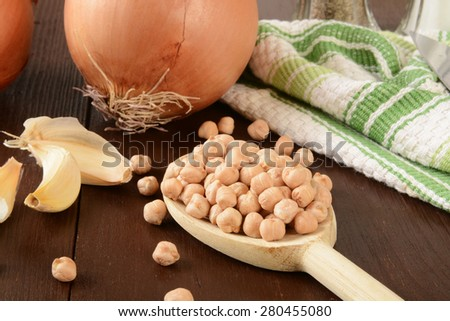 Chickpeas or garbanzo beans, onion, and garlic closes as ingredients for hummus - stock photo