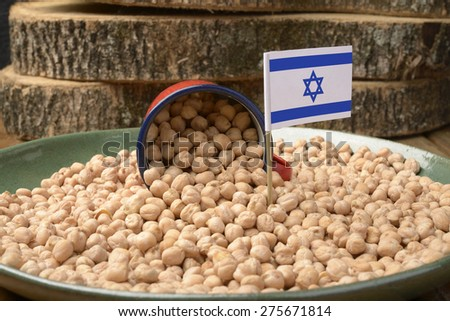 Chickpeas or Garbanzo Beans With Israel Flag - stock photo