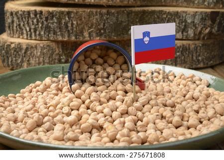 Chickpeas or Garbanzo Beans With Slovenia Flag - stock photo