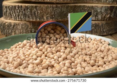 Chickpeas or Garbanzo Beans With Tanzania Flag - stock photo