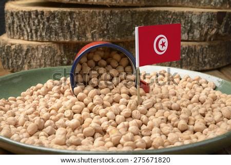 Chickpeas or Garbanzo Beans With Tunisia Flag - stock photo