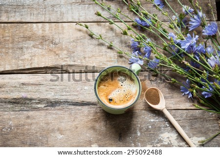 Chicory drinks and flowers - stock photo