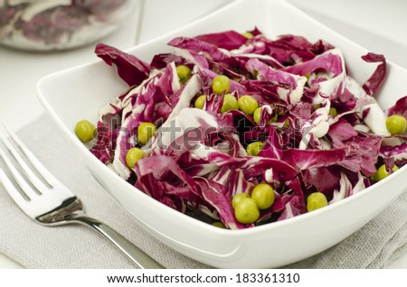 Chicory salad with pea - stock photo
