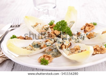 chicory salad with walnut and roquefort - stock photo
