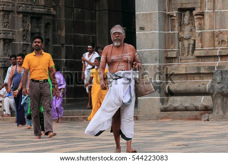 CHIDAMBARAM, INDIA - JUL 15 : An unidentified Brahmin priest enters the Nataraja temple on July 15, 2015 in Chidambaram, India. Brahmins are the prevailing priests in most of the temples in India.