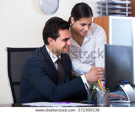 Chief manager consulting and tutoring employee in modern office  - stock photo
