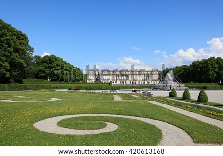 CHIEMSEE, GERMANY - MAY 11, 2011: View of Herrenchiemsee palace on May 11, 2011 in Chiemsee, Germany. It is a landmark palace in Germany and an imitation of Versailles palace. - stock photo