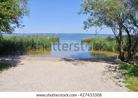 Chiemsee, sandy beach, reed, lake - stock photo