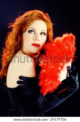 Chik redhead woman with scarlet fan - stock photo