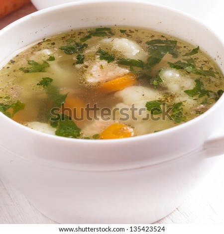 Chiken cauliflower and carrot soup in a white cup - stock photo