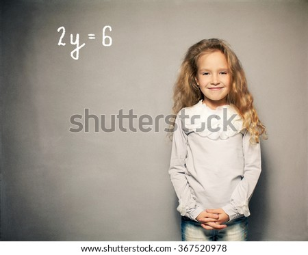 Child about school board. Girl near blackboard - stock photo