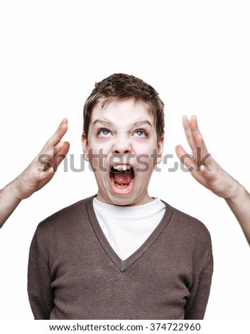 Child abuse/fosterage concept. Human face expression. Screaming boy face. Adult hands reach to the child. Studio shot, isolated on white. - stock photo