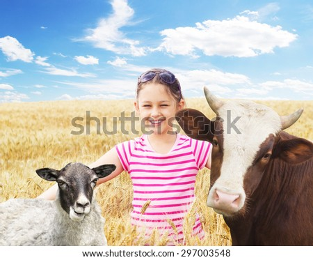 child and a cow and a sheep - stock photo